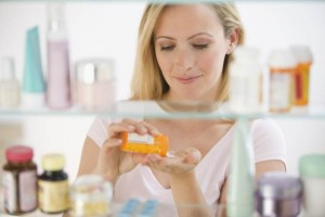 Woman looking in medicine cabinet.jpg.838x0_q67_crop-smart-2